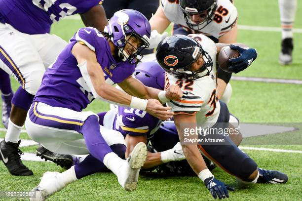 Eric Wilson of the Minnesota Vikings and Troy Dye attempt to tackle David Montgomery of the Chicago Bears during the first half at U.S. Bank Stadium...