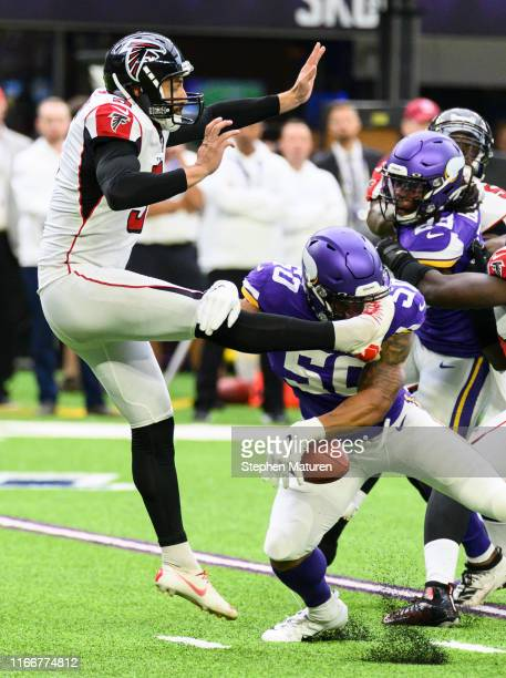 Eric Wilson of the Minnesota Vikings blocks the punt of Matt Bosher of the Atlanta Falcons in the first quarter of the game at U.S. Bank Stadium on...
