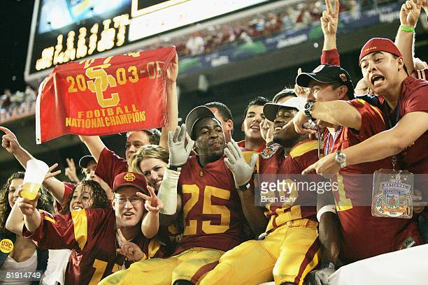 Eric Wright and Desmond Reed of the USC Trojans celebrate in the stands after defeating the Oklahoma Sooners 5519 to win the FedEx Orange Bowl 2005...