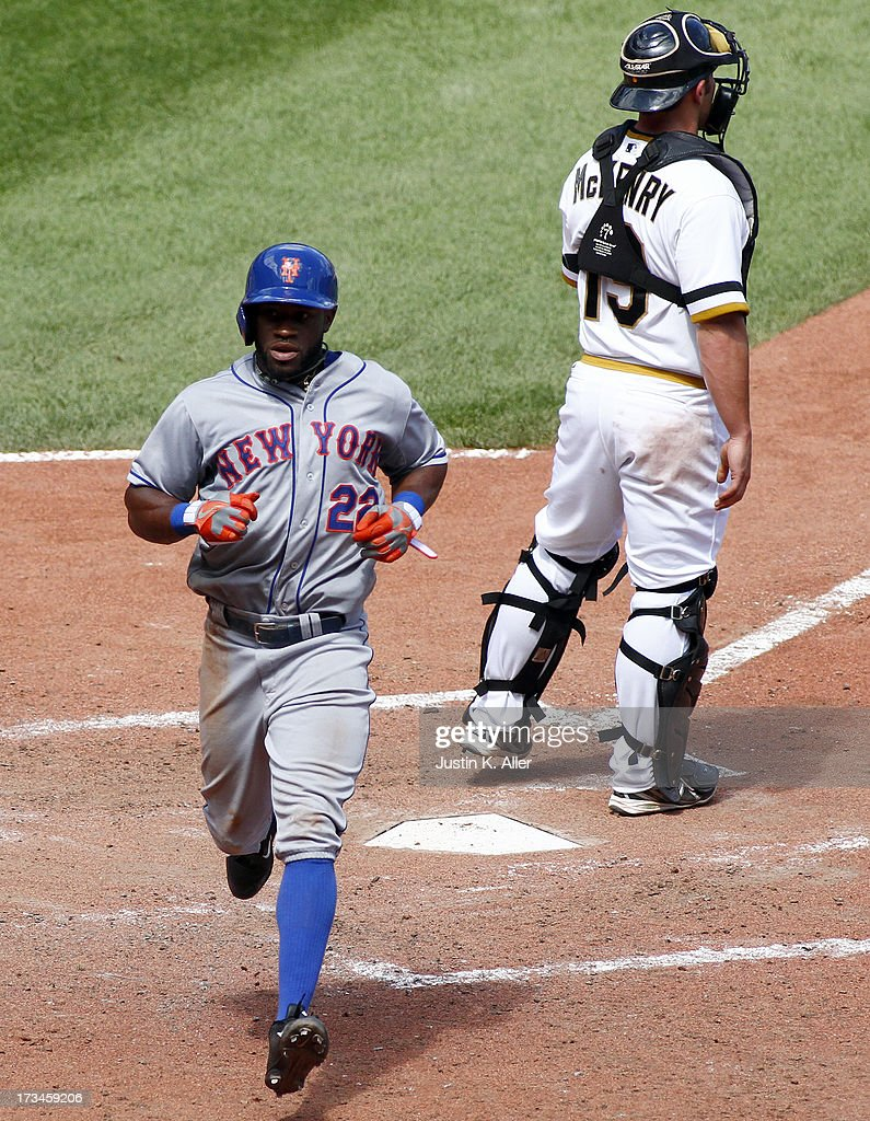 Eric Young Jr. #22 of the New York Mets celebrates after scoring on an RBI triple in the seventh inning against the Pittsburgh Pirates during the game on July 14, 2013 at PNC Park in Pittsburgh, Pennsylvania. The Mets won 4-3.