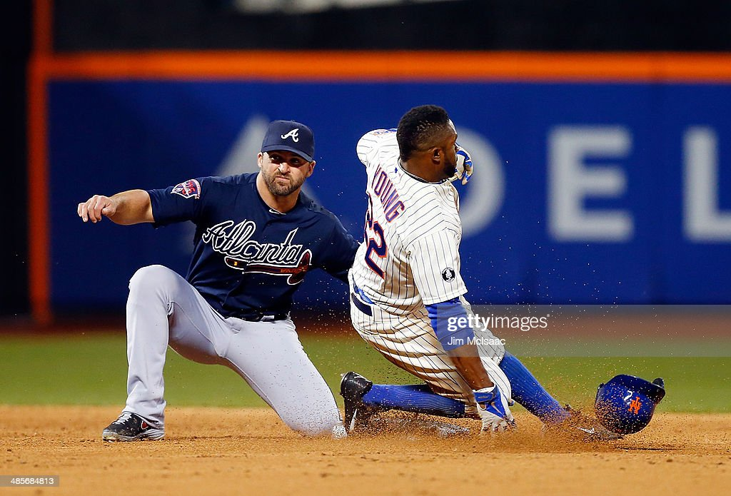 Eric Young Jr. #22 of the New York Mets is caught stealing second base in the third inning against Dan Uggla #26 of the Atlanta Braves at Citi Field on April 19, 2014 in the Flushing neighborhood of the Queens borough of New York City.