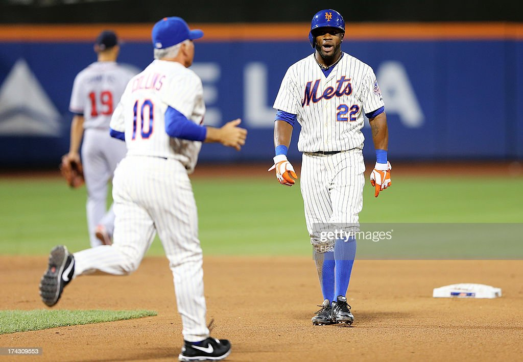 Eric Young Jr. #22 of the New York Mets reacts after he is caught stealing second as manager Terry Collins #10 runs out to argue the call in the seventh inning against the Atlanta Braves on July 23, 2013 at Citi Field in the Flushing neighborhood of the Queens borough of New York City.