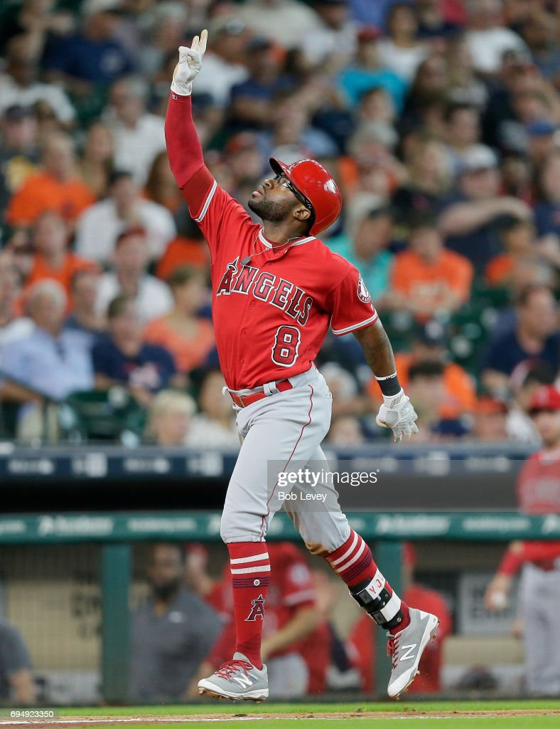 Eric Young Jr. #8 of the Los Angeles Angels of Anaheim celebrates hitting a three-run home run in the fifth inning against the Houston Astros at Minute Maid Park on June 11, 2017 in Houston, Texas.