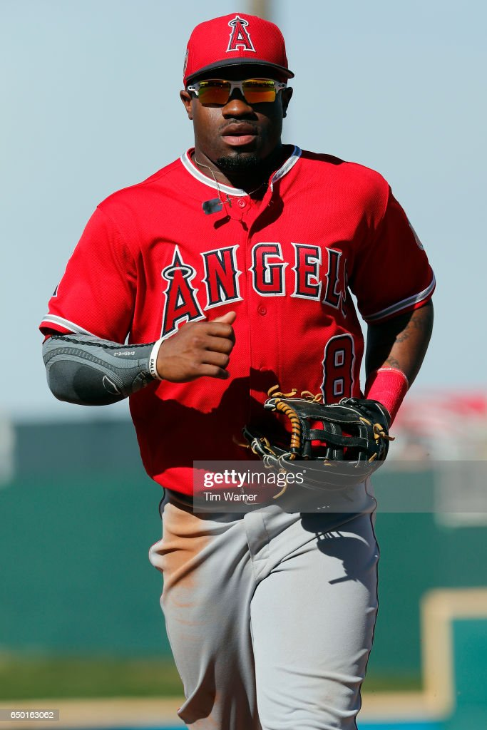 Eric Young Jr. #8 of the Los Angeles Angels runs to the dugout during the spring training game against the Cincinnati Reds at Goodyear Ballpark on March 8, 2017 in Goodyear, Arizona.