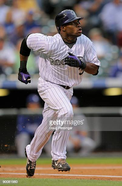 Eric Young Jr of the Colorado Rockies leads off the first inning with a fly out to right field in his Major League Baseball debut in a game against...