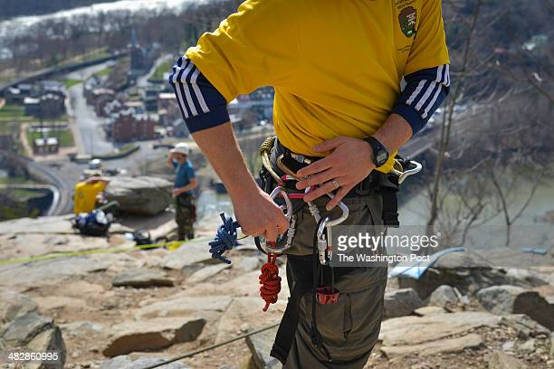 Eric Yount of Shenandoah National Park is among the search and rescue workers preparing to descend down cliffs overlooking Harpers Ferry as the...