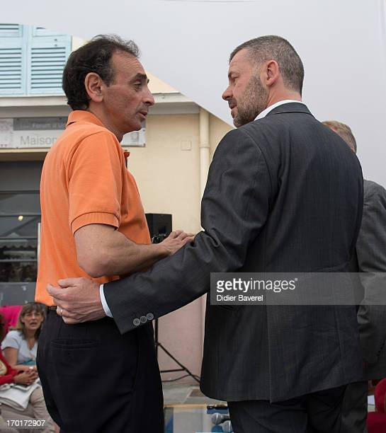 Eric Zemmour and Eric Naulleau attend the 'Festival du Livre de Nice' 2013 on June 8 2013 in Nice France