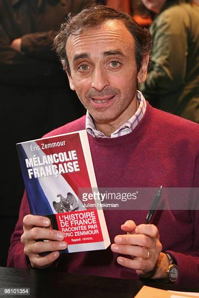 Eric Zemmour signs copies of his book 'Melancolie francaise' at the 30th salon du livre at Porte de Versailles on March 28 2010 in Paris France