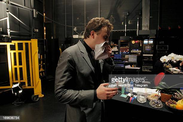 Eric Zuber of the United States cools off with a drink of water after his second recital during the sixth day of the preliminary round of the 14th...