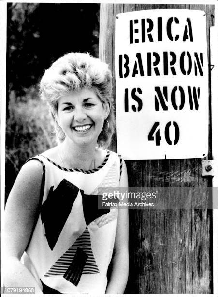 Erica Barron standing beside one of the 40 posters put up by her friends in Glen Haven after her Fortieth Birthday. January 10, 1986. .