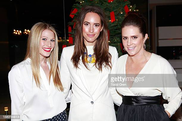 Erica Bell TV Host Louise Roe and Katie Finnegan pose at the Hukkster Holiday Party at a Private Residence on December 12 2012 in Los Angeles...