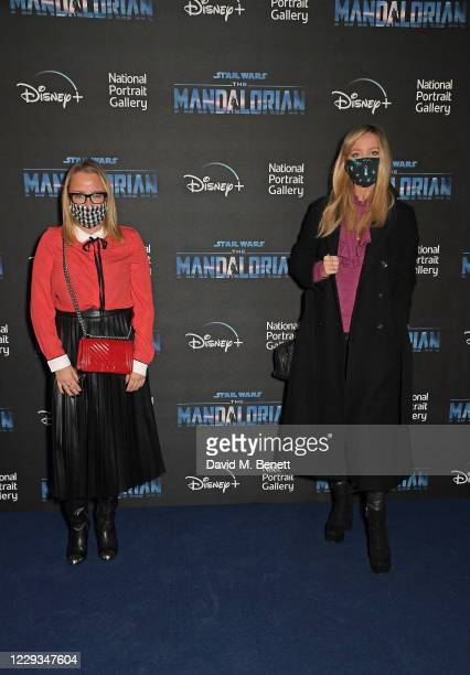 """Erica Bergsmeds and Laura Whitmore attend a private view of """"The Mandalorian And The Child"""", a special portrait being unveiled in collaboration with..."""