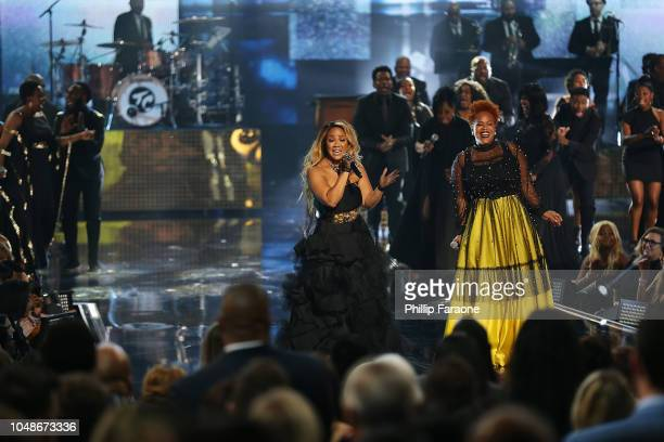 Erica Campbell and Tina Campbell of Mary Mary perform onstage the 2018 American Music Awards at Microsoft Theater on October 9 2018 in Los Angeles...