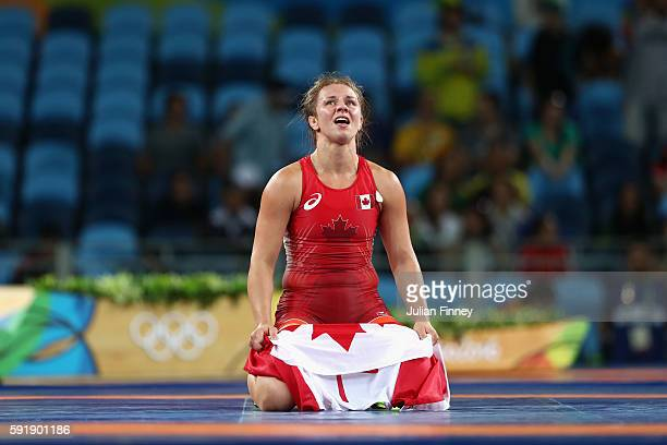 Erica Elizabeth Wiebe of Canada celebrates after defeating Guzel Manyurova of Kazakhstan during the Women's Freestyle 75 kg Gold medal match on Day...