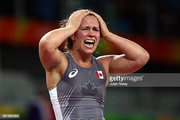 Erica Elizabeth Wiebe of Canada celebrates after defeating Vasilisa Marzaliuk of Belarus during the Women's Freestyle 75 kg Semifinals match on Day...