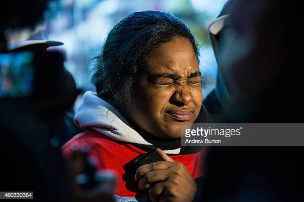 Erica Garner daughter of Eric Garner holds back tears while speaking to the media after leading a march of people protesting the Staten Island New...