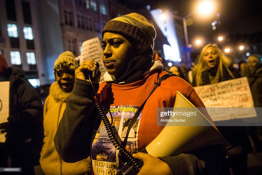 Erica Garner, daughter of Eric Garner, leads a march of people protesting the Staten Island, New York grand jury's decision not to indict a police officer involved in the chokehold death of Eric Garner in July, on the night of December 11, 2014 in the Staten Island Neighborhood of New York City. Protests have continued throughout the country since the Grand Jury's decision was announced last week.