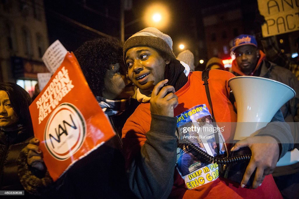 Erica Garner, daughter of Eric Garner, leads a march of people protesting the Staten Island, New York grand jury's decision not to indict a police officer involved in the chokehold death of Eric Garner in July, on December 11, 2014 in the Staten Island Neighborhood of New York City. Protests have continued throughout the country since the Grand Jury's decision was announced last week.