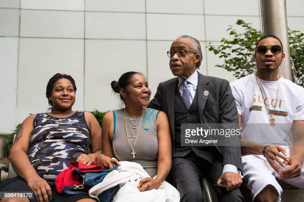 Erica Garner daughter of the late Eric Garner Esaw Garner widow of Eric Garner and Rev Al Sharpton speak with each other before meeting with...