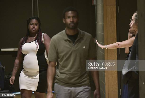 Erica Garner the daughter of Eric Garner who was choked to death by New York City police is seen outside of the theater where US President Barack...
