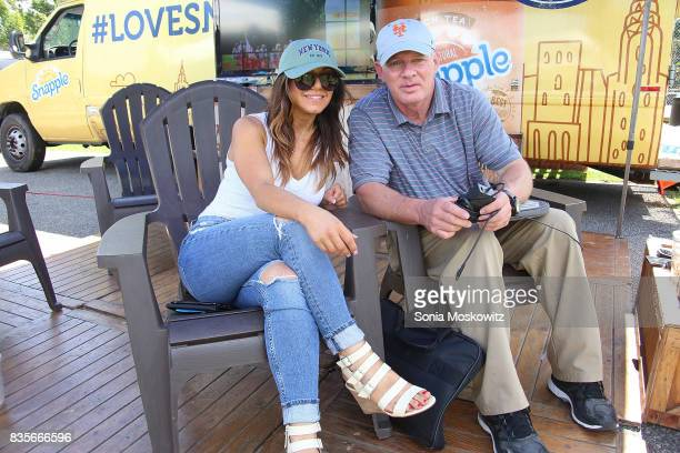 Erica Giuliani and Lenny Dykstra attend the 69th Annual Artists and Writers Softball Game at Herrick Park on August 19 2017 in East Hampton New York
