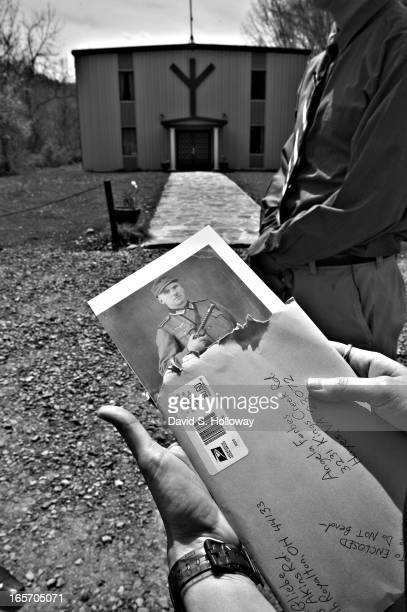 Erica Gliebe looks at a photo of her husband Erich Gliebe's grandfather whom he claims was a member of the german army during World War II at the...