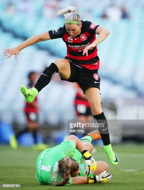 Erica Halloway of the Wanderers avoids Victory goalkeeper Casey Dumont during the round 12 WLeague match between the Western Sydney Wanderers and the...