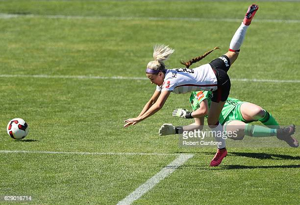 Erica Halloway of the Wanderers is fouled by Victory goalkeeper Bethany MasonJones during the round six WLeague match between Melbourne Victory and...