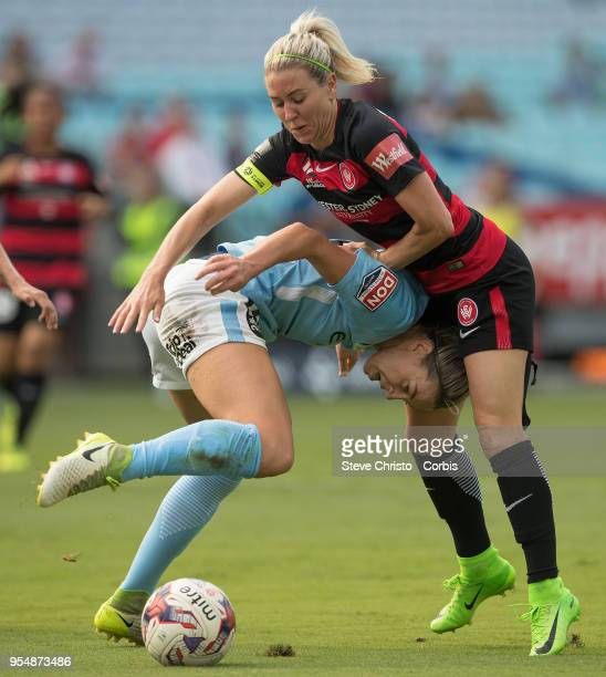 Erica Halloway of the Western Sydney Wanderers gets tangled up in this challenge with City's Alanna Kennedy during the round nine W-League match...
