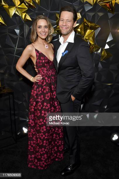 Erica Hanson and Ike Barinholtz attend the 2019 Netflix Primetime Emmy Awards After Party at Milk Studios on September 22 2019 in Los Angeles...