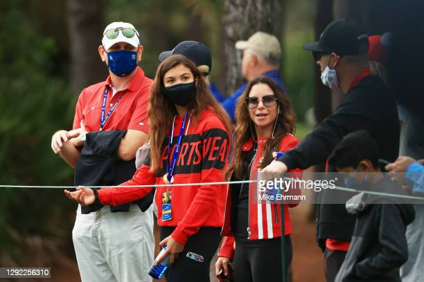 Erica Herman and Sam Woods look on during the final round of the PNC Championship at the Ritz-Carlton Golf Club Orlando on December 20, 2020 in...