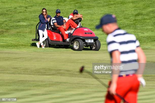 Erica Herman Captain's Assistant Tiger Woods and Notah Begay watch Daniel Berger of the US Team putt on the 15th hole green during Sunday Singles...