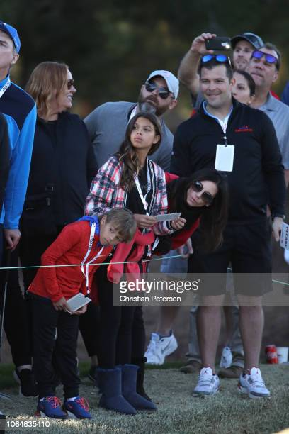 Erica Herman girlfriend of Tiger Woods and his children Sam and Charlie look on during The Match Tiger vs Phil at Shadow Creek Golf Course on...