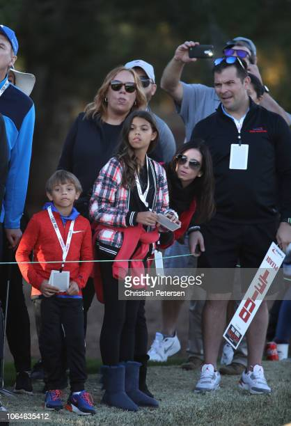 Erica Herman, girlfriend of Tiger Woods, and his children Sam and Charlie look on during The Match: Tiger vs Phil at Shadow Creek Golf Course on...