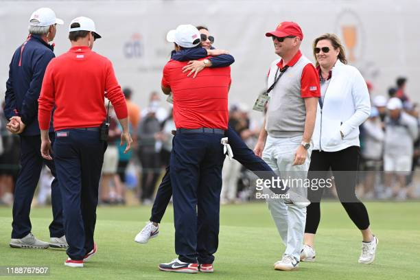 Erica Herman girlfriend of U.S. Team Captain Tiger Woods hugs U.S. Teams Patrick Reed after his match during the final round singles matches at the...