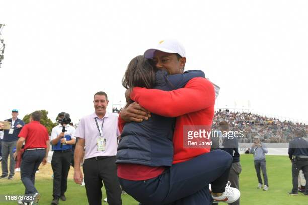 Erica Herman hugs U.S. Team Captain Tiger Woods during the final round singles matches at the Presidents Cup at The Royal Melbourne Golf Club on...