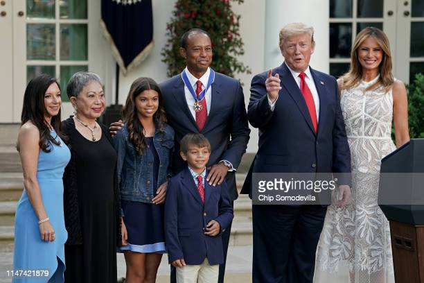 Erica Herman Kultida Woods Sam Alexis Woods Charlie Axel Woods Tiger Woods US President Donald Trump and first lady Melania Trump pose for...