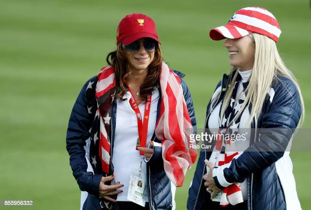 Erica Herman talks to Justine Reed wife of Patrick Reed of the US Team during Saturday foursome matches of the Presidents Cup at Liberty National...