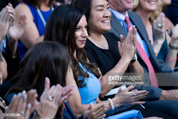 Erica Herman watches as her boyfriend US golfer Tiger Woods receives the Presidential Medal of Freedom during ceremony in the Rose Garden of the...