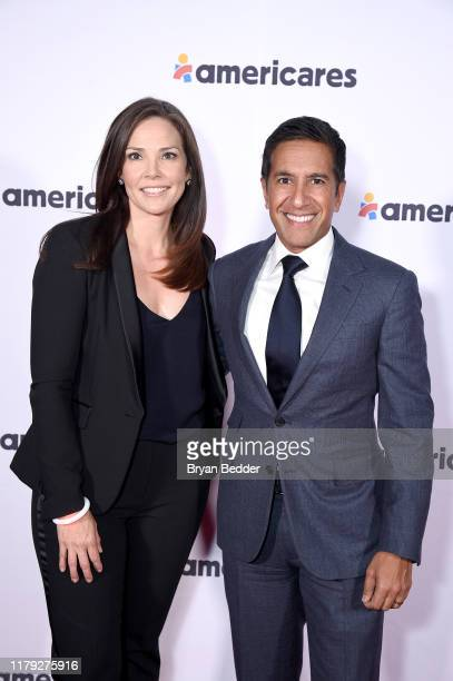 Erica Hill and Dr Sanjay Gupta attend the 2019 Americares Airlift Benefit at JPMorgan Chase Hangar at Westchester County Airport on October 05 2019...