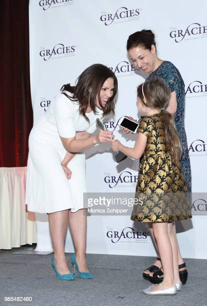 Erica Hill presents an award onstage at The Gracies presented by the Alliance for Women in Media Foundation at Cipriani 42nd Street on June 27 2018...