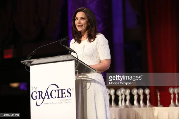 Erica Hill speaks onstage at The Gracies presented by the Alliance for Women in Media Foundation at Cipriani 42nd Street on June 27 2018 in New York...