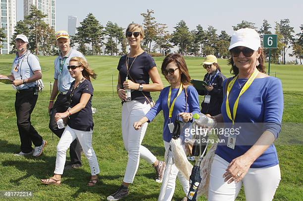 Erica Holmes and Angie Watson walk alongside Kim Choi and Sue Price during the Thursday foursomes matches at The Presidents Cup at Jack Nicklaus Golf...
