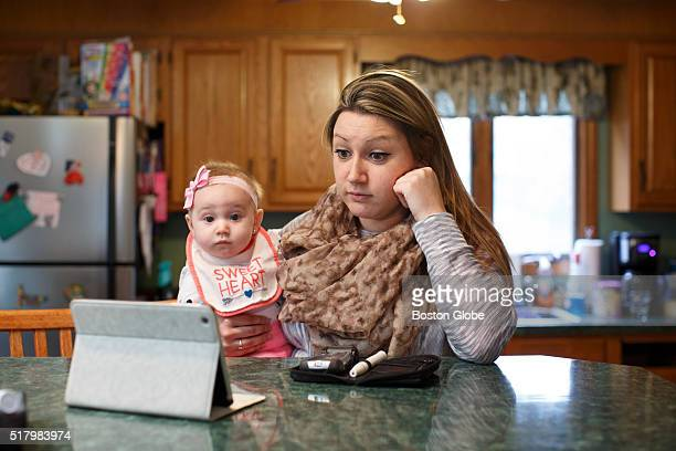 Erica Jensen with her 5monthold daughter Charlee Jaques by her side video conferenced with her doctor Dr Marie McDonnell from her mother's home in...