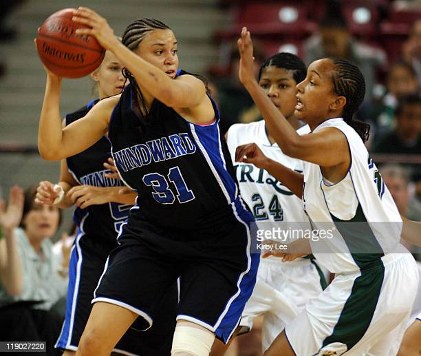 Erica Latimer of Windward is defended by Kishawna Moore and Monique Garrett of Sacred Heart Cathedral of San Francisco during the Division II girls...