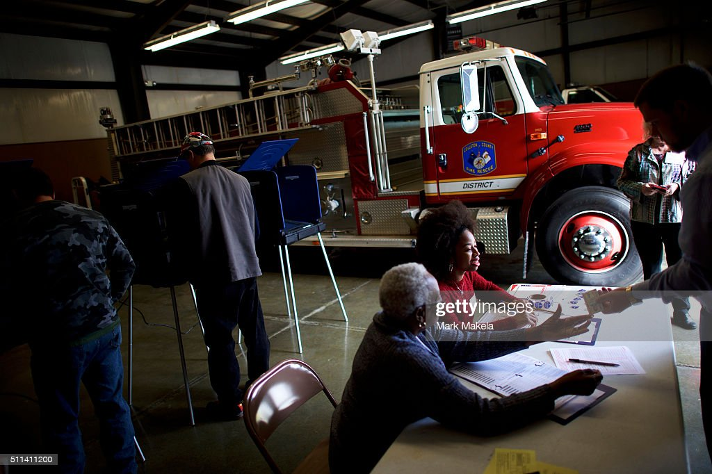 Erica Levine, 20, a poll manager at the Colleton County Fire & Rescue polling precinct registers a voter on February 20, 2016 in Walterboro, South Carolina. Statewide voters will cast ballots today in the South Carolina Republican Presidential Primary, the 'first in the south.'