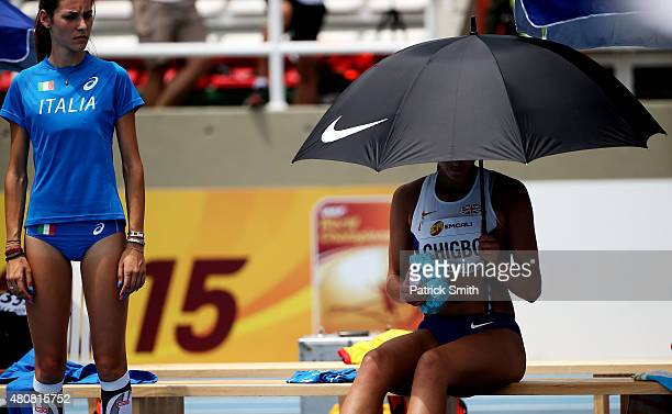 Erica Marchetti of Italy looks on as Adaora Chigbo of Great Britain uses an ice pack during qualification for the Girls High Jump on day one of the...