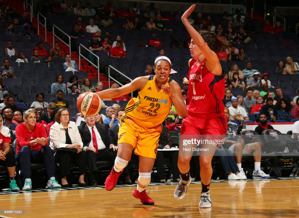Erica McCall #22 of the Indiana Fever handles the ball against the Washington Mystics on August 12, 2017 at the Verizon Center in Washington, DC.