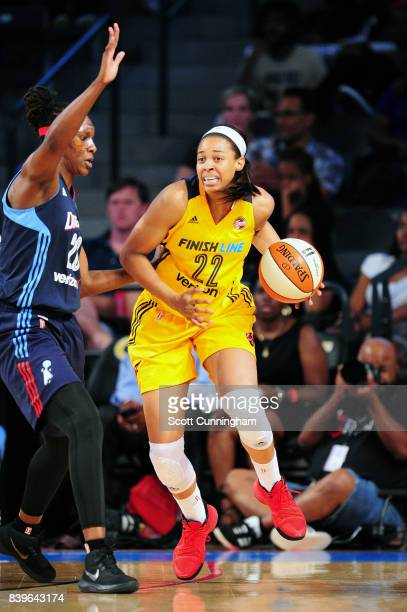 Erica McCall of the Indiana Fever handles the ball during the game against the Atlanta Dream during a WNBA game on August 26 2017 at Philips Arena in...