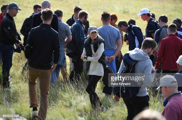 Erica McIlroy helps look for husband Rory McIlroys ball on the 17th hole during day one of the British Masters at Close House Golf Club on September...